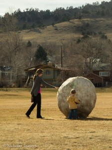 Family plays with Large Snowball in North Boulder Park
