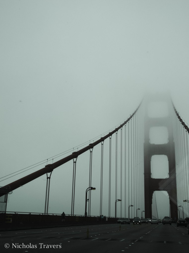 Crossing the Golden Gate Bridge in fog, so long San Fransisco, hello Marin