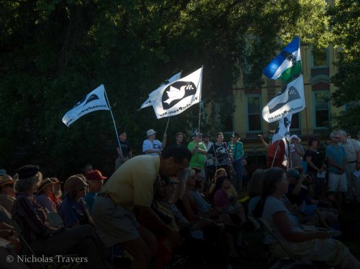 flags wave from Veterans for Peace; at At Hiroshima, Nagasaki, & Hanford: A Tragic Connection; Tuesday August 6th, 2013