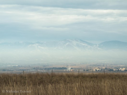 A layer of warm air is trapped by a colder layer beneath the foothills north of Boulder, Colorado. (November 24th, 2013)