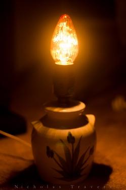 a lamp glows through the night