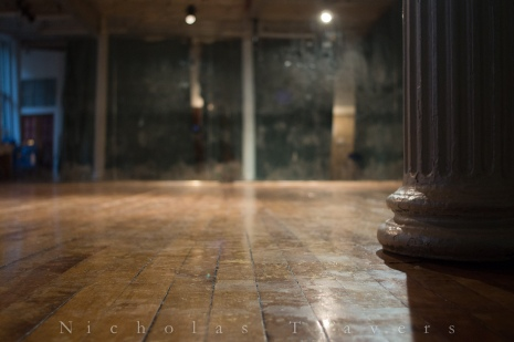 floor, column, and mirror in the dance space at 100 grand