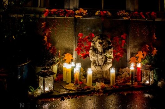Dia de los muertos altar by night, fully celebrating, honoring, holding, working.